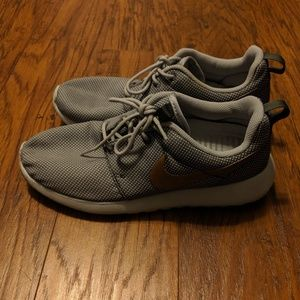 Gray and gold Nike shoes size 8